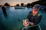 Roger Belton (founder of Southern Clams Ltd) checking Littleneck clams (Austrovenus stutchburyi) harvested from Blueskin Bay, on a pre-dawn start dictated by tides, Dunedin, Dunedin City (54334QF00)