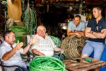Tony Muollo, with father Carlo, brother Dion and nephew Josh, share a laugh while working on fishing equipment. All involved with the fishing industry, Wellington, Wellington City (54434QF00)