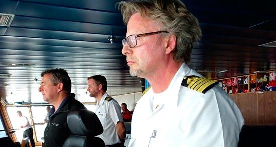 Capt Dag H. Saevik, Master of MV The World, concentrating on furthest south record