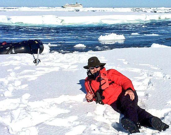Rob Suisted on ice. A smoko break from driving zodiacs amongst pack ice, Ross Sea, Antarctica