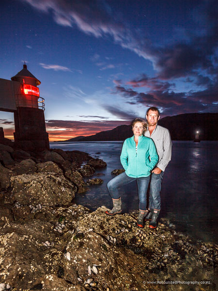 Georgie (nee King) and Scott Archibold farming at French Pass, with D'Urville Island behind, where Georgie's family goes way back. Story Portrait by Rob Suisted