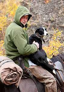 Stockman Tom O'Sullivan checking heading dog
